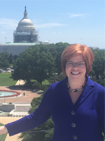 A picture of NCTE Executive Director Emily Kirkpatrick from the roof deck of our new DC office.